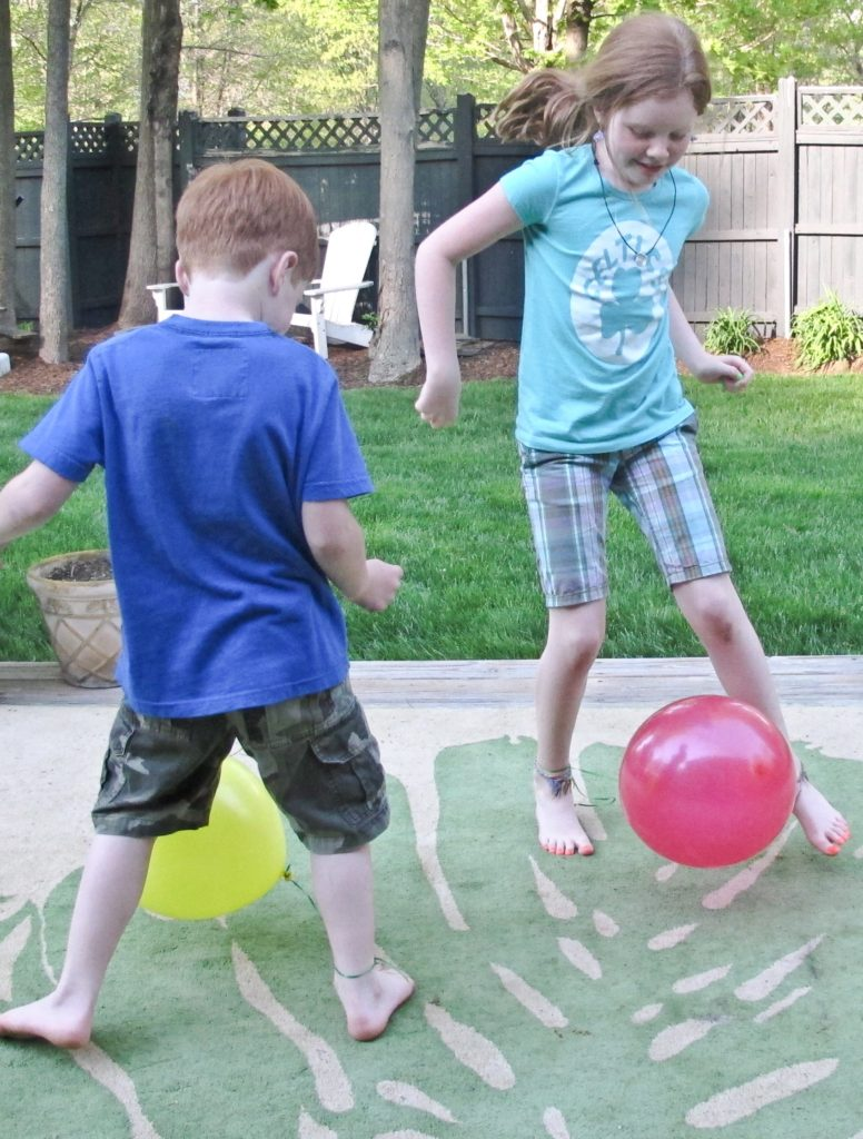 """The balloon pop is a great game for children of all ages. Have each party guest blow up a balloon and, using ribbon or string, tie it loosely to their ankle. When you say """"Go!"""" guests have to try and pop each other's balloon's without getting their own balloon popped. The last person with a balloon left un-popped is the winner!"""