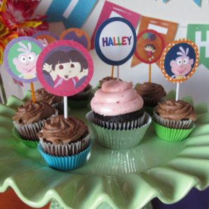 Dora the Explorer Cupcakes | Cupcakes are the perfect addition to any party. We made chocolate cupcakes with chocolate frosting, and used Dora the Explorer cupcake toppers to add some fun and color to the table.