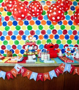 You can create a simple, cost-effective dessert table for your party anywhere with these 5 simple steps! We set up this Elmo party on a kitchen island.
