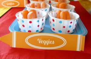 DIY Elmo Party Ideas | Our Elmo Party was a little last minute and I didn't have time to order colored treat cups, so I had to get creative. I found these plain white cups at Party City. Using the flat eraser on a pencil, I used craft paint to polka-dot them in the red and blue colors of the party. They were great for carrots and dip at the party, and the kids even ate the carrots!