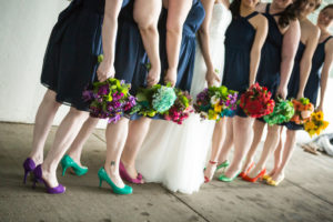 Minneapolis Real Wedding | Bridesmaids wore navy dresses from Target with different color shoes, all matching their bouquets. Red, salmon, yellow, kate spade green, teal, purple, and pink.