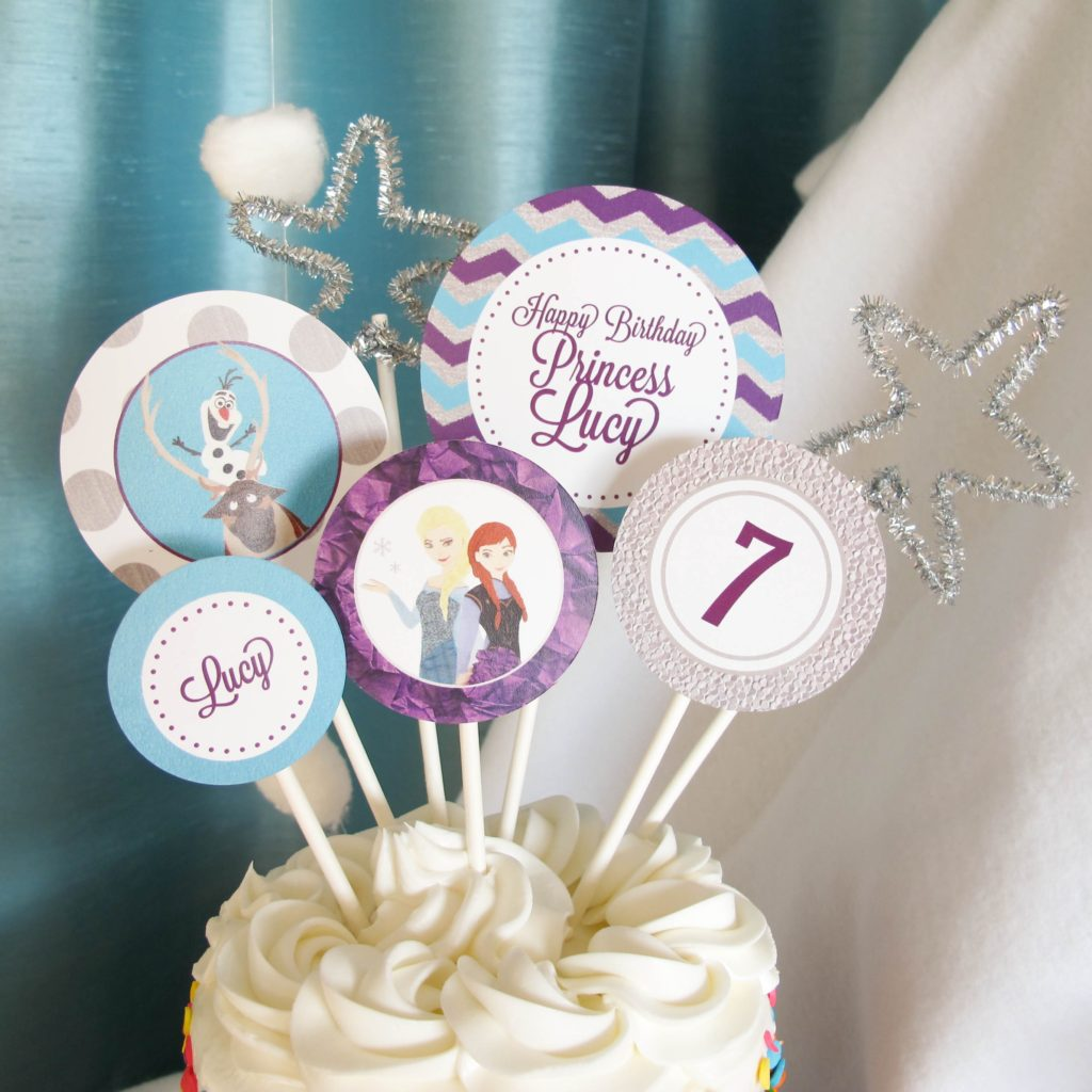 Frozen Birthday Cake: We purchased a small cake from the grocery store and decorated it with these Customized Frozen Cake toppers, adding a few silver pipe cleaner shapes for some sparkle.