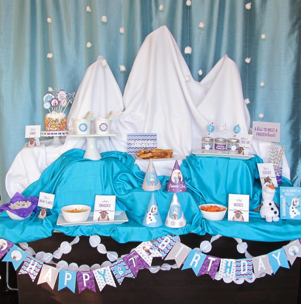 Disney Frozen Party Ideas | This Winter Wonderland Frozen party was created on the center island in my kitchen using boxes, fabric, curtains, and a few cotton balls. The girls loved...