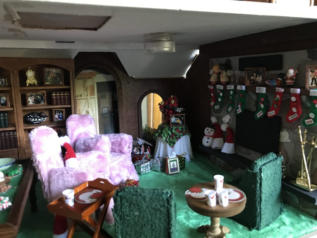 Dollhouse miniature family room at Christmas, fireplace with stockings